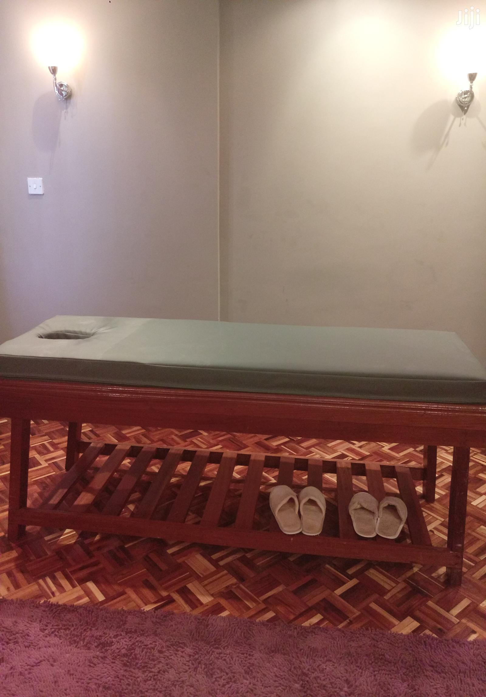 Archive: Hard Wood Massage Bed With High Density Mattress