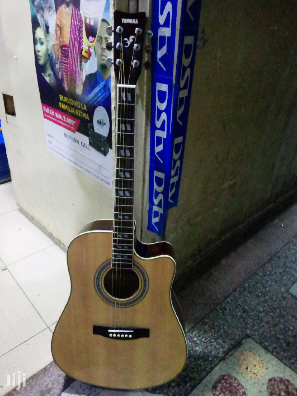 Natural Color Yamaha Guitar.