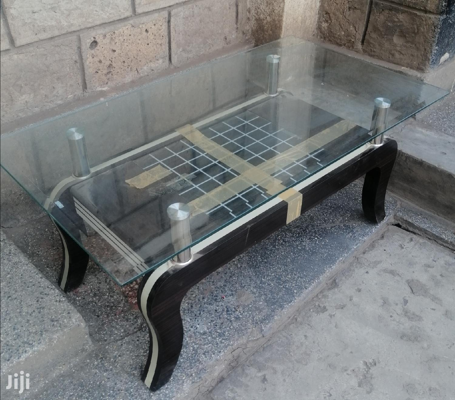 Glass Coffee Table With Wooden Stands