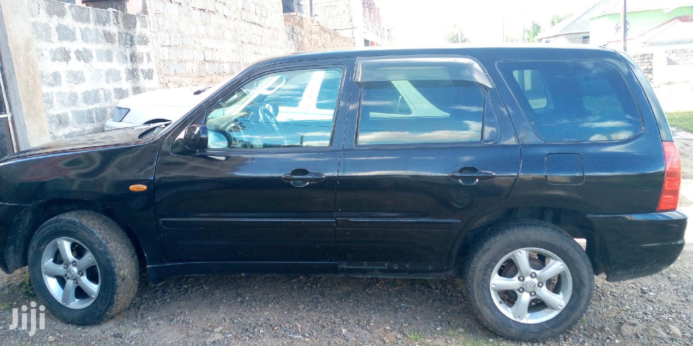 Archive: Mazda Tribute 2005 2.0 Comfort 4WD Black