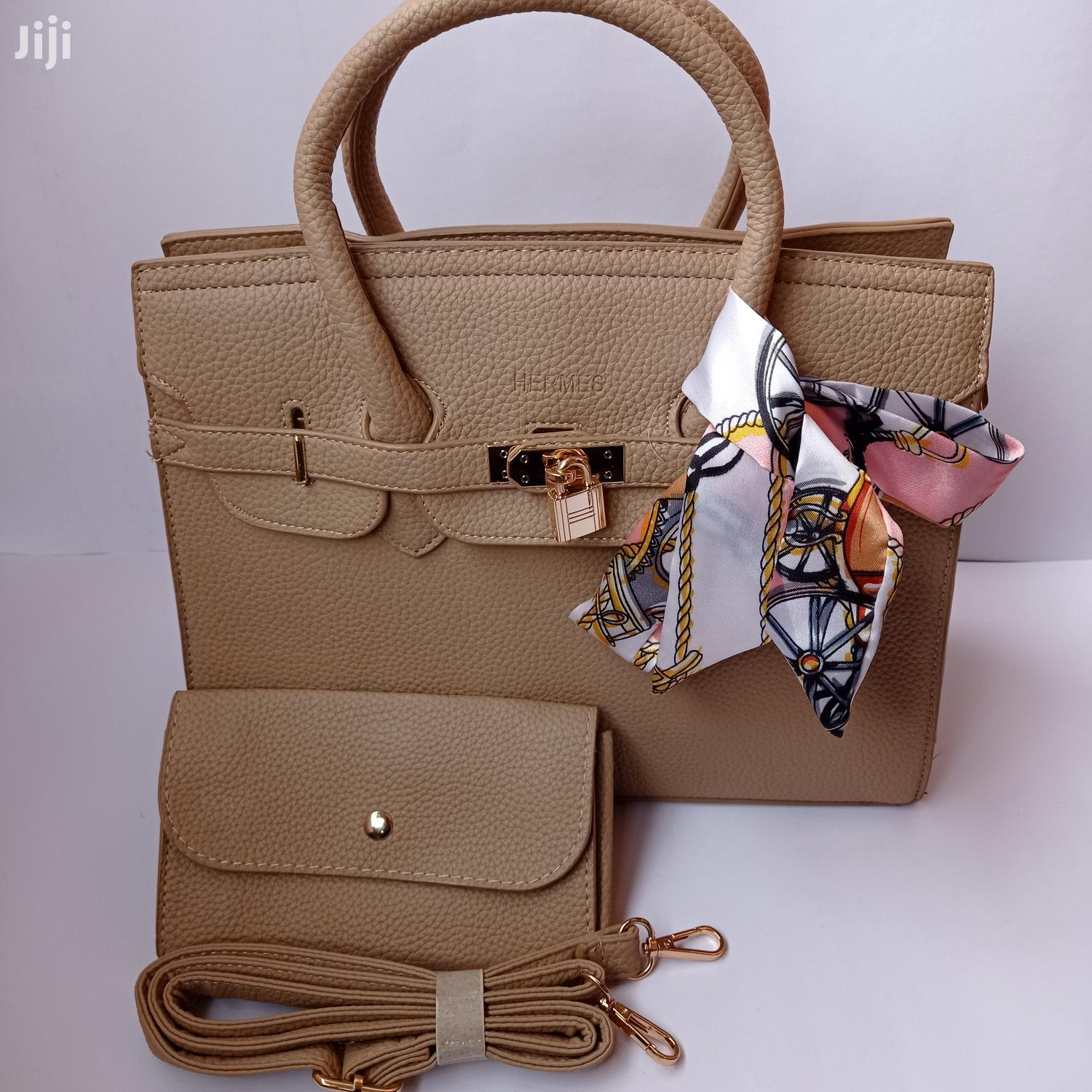 Beige Handbags With a Silk Scarf Available