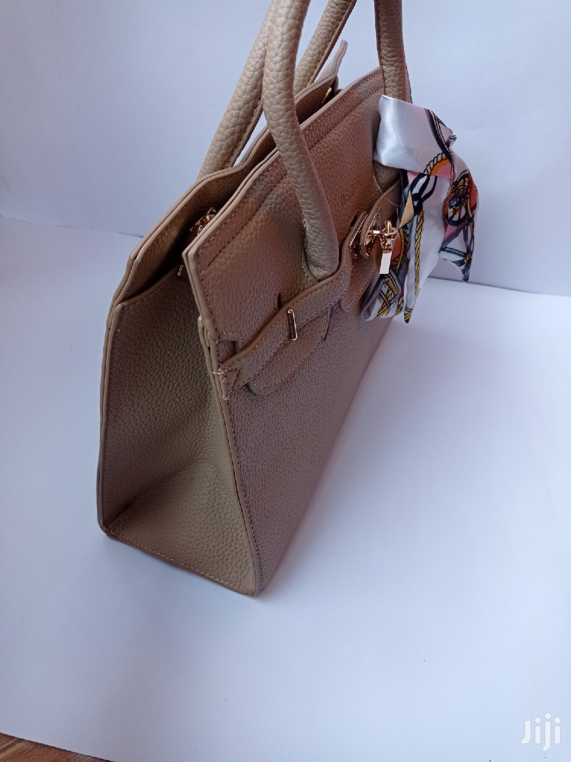 Beige Handbags Available