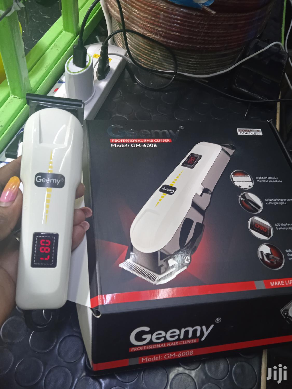 Geemy Proffessional Lcd Display Rechargeable Hair Clipper