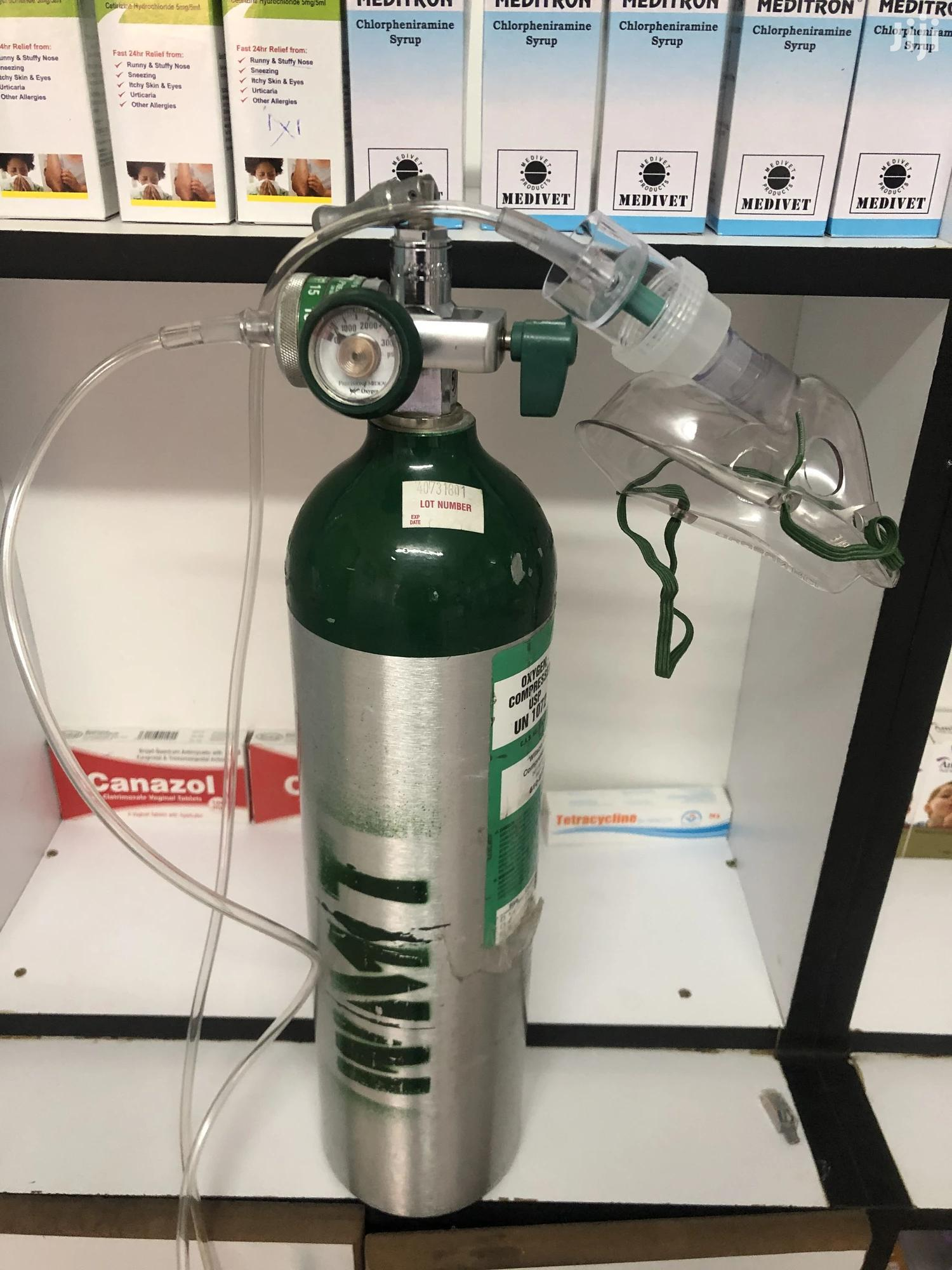 Oxygen Tank, Flow Meter And Mask