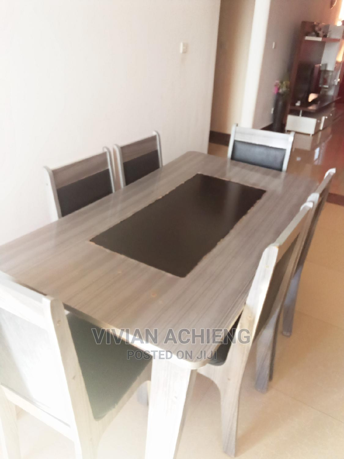 Archive: 5 Seater Dining Table and Chairs