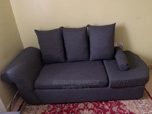 A 3 Seater Sofa, Grey in Color! It'S Going for 15000   Furniture for sale in Nairobi, Kasarani