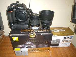 Nikon D5600 + 18-55mm + 50mm Prime Lens (Yongnuo)+ Charger   Photo & Video Cameras for sale in Nairobi, Githurai
