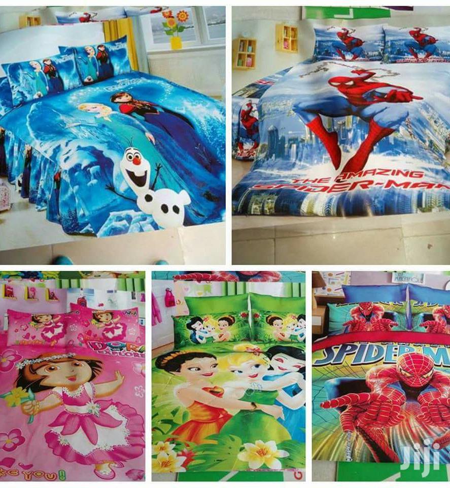 Cartoon Kids Duvets With A Matching Bed Sheet And A Pillow Case.