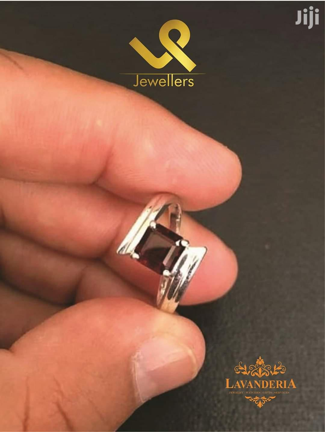 Custom Made Ladies Gold Engagement Ring With Red Garnet