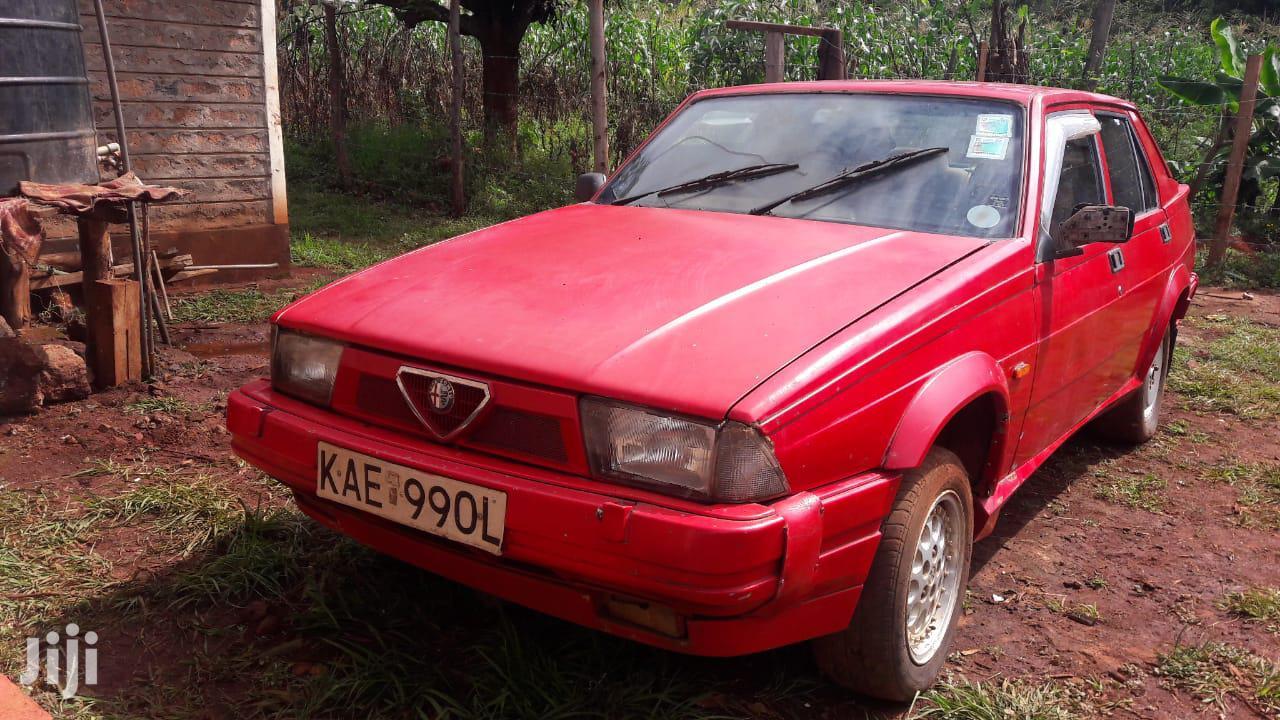 Archive: Alfa Romeo 75 2000 Red
