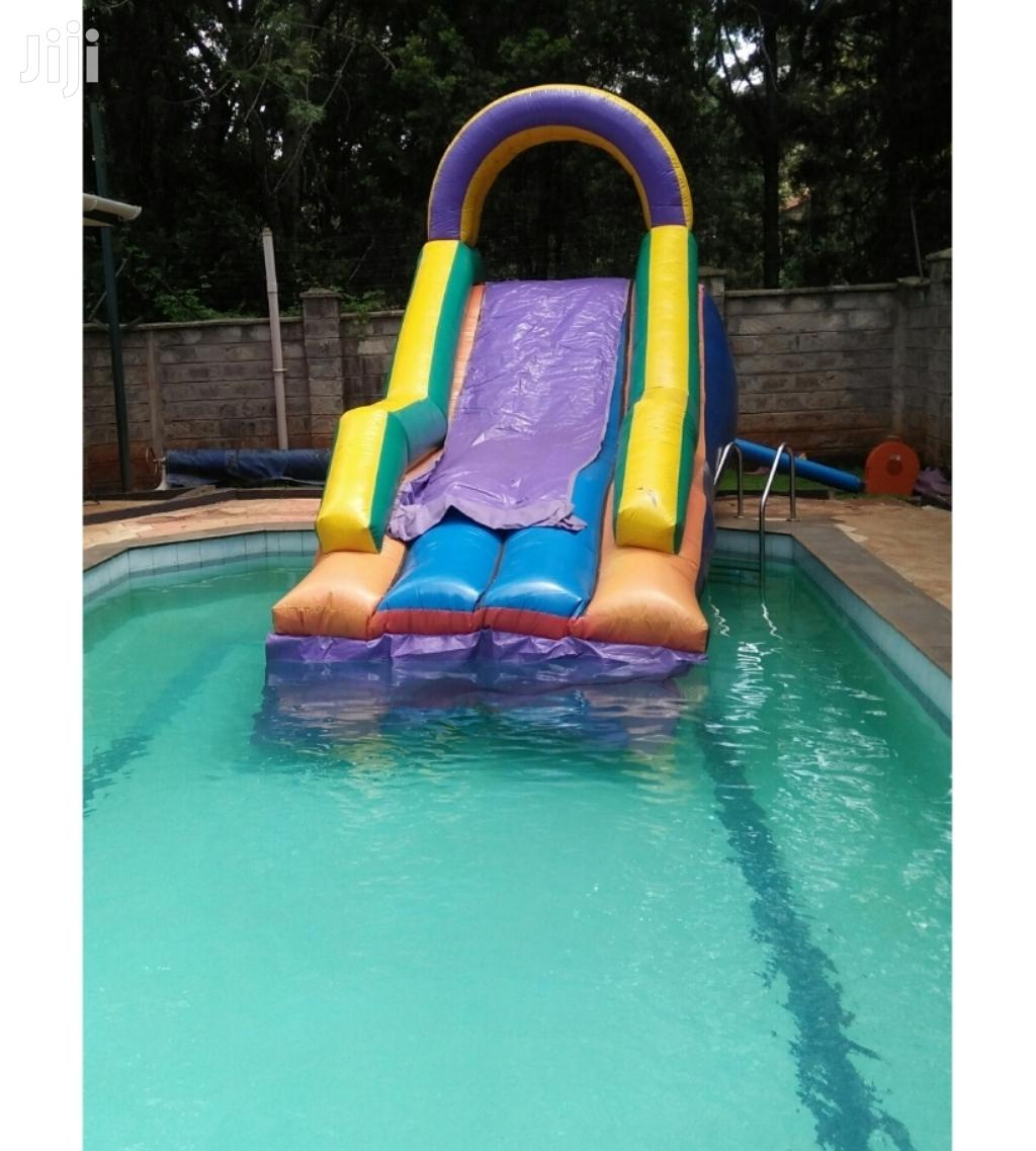 Archive: Water Pool and Slide, Wall Climber, Themed Bouncing Castles